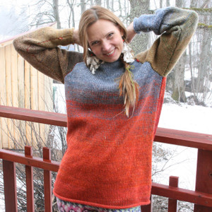 Fall Sky orange rust blue grey taupe reversible unisex raglan pullover worn by female model, designed and knit by Wrapture by Inese