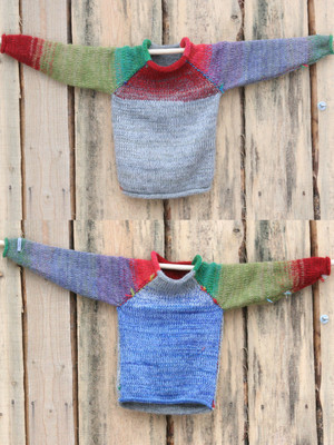 Yak and Pony grey red green blue reversible unisex raglan pullover showing both sides in a double photograph where the sweater is hung on a wood shed, designed and knit by Wrapture by Inese