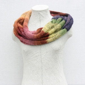 Purple Avens kid mohair and silk one of a kind loop scarf on dress form with white background. Knit by Inese in purple lime green, coral, brown, rose kid mohair.
