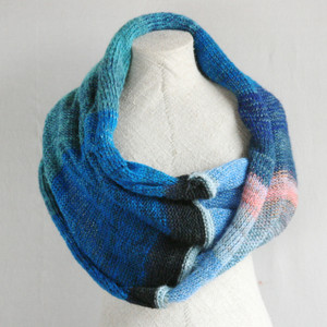 Catalonian Sea shawl wrap on dress form knit by Inese for Wrapture by Inese inblue teal pink