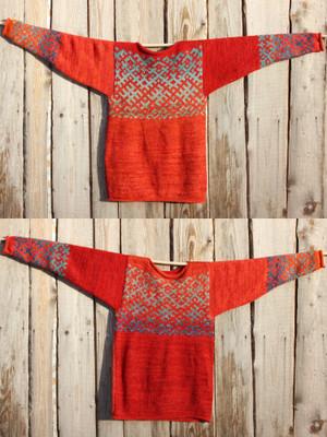view of both sides of reversible unisex Uguns un Nakts Latvian symbols sweater size L