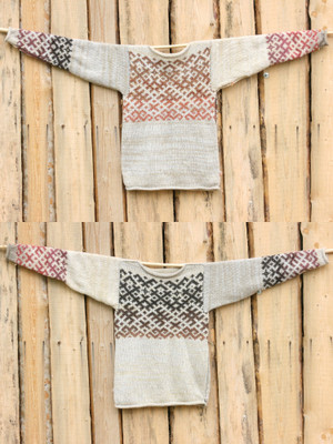view of both sides of size S reversible unisex Snow Latvian symbols sweater flat on side of woodshed white, beige, dusty rose shades