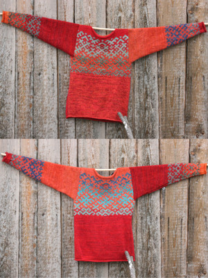 Red Orange reversible unisex Latvian symbols sweater size M both sides shown hung flat on a woodshed, knit with wool, kid mohair, silk, cotton by Wrapture by Inese