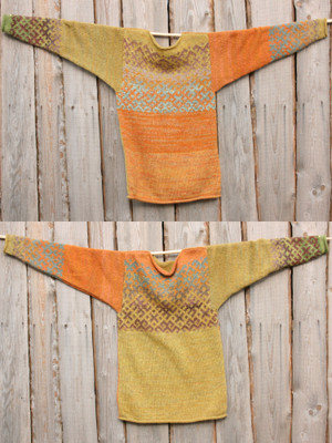 Mustard XL reversible Latvian symbols sweater in double photo hung flat on a wooden wall showing both sides, knit by Wrapture by Inese