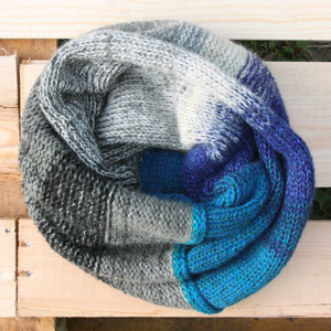 Adriatic blue grey color way snood cowl flat on wood pallet background, knit by Inese Iris Liepina for Wrapture by Inese.