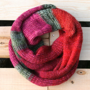 Autumn rose red fuchsia sage green color way snood cowl flat on wood pallet background, knit by Inese Iris Liepina for Wrapture by Inese.