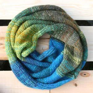 Mongolian Trek color way snood cowl flat on wood pallet background, knit by Inese Iris Liepina for Wrapture by Inese.