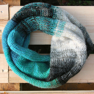 New Zealand Lake color way snood cowl flat on wood pallet background, knit by Inese Iris Liepina for Wrapture by Inese.
