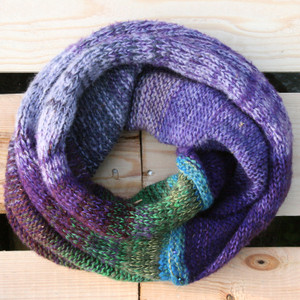 Pansies color way snood cowl flat on wood pallet background, knit by Inese Iris Liepina for Wrapture by Inese.