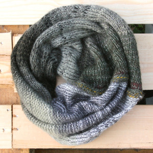 Pond color way snood cowl flat on wood pallet background, knit by Inese Iris Liepina for Wrapture by Inese.