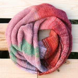 Purple Avens color way snood cowl flat on wood pallet background, knit by Inese Iris Liepina for Wrapture by Inese.