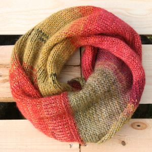 Rowan Tree color way snood cowl flat on wood pallet background, knit by Inese Iris Liepina for Wrapture by Inese.