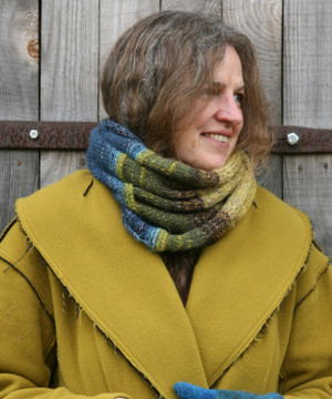Summer storm color way snood cowl worn by Inese Iris Liepina the knitter and designer for Wrapture by Inese.