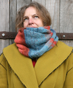 Tuja Beach color way snood cowl worn by Inese Iris Liepina the knitter and designer for Wrapture by Inese.