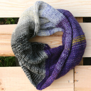 Violet Ice color way snood cowl flat on wood pallet background, knit by Inese Iris Liepina for Wrapture by Inese.