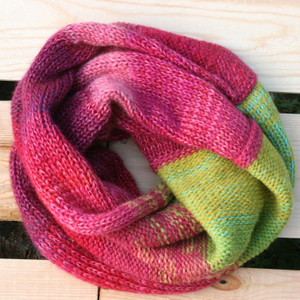 Waterlilies color way snood cowl flat on wood pallet background, knit by Inese Iris Liepina for Wrapture by Inese.