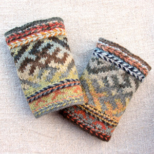 Life symbol boot toppers in a combination of Bearded Rocks and Catalonian Road  color ways, hand knit by Inese iris Liepina