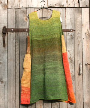 Apples trapeze dress on coathanger hung on woodshed door knit by Inese iris Liepina of Wrapture by Inese