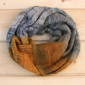 Bearded Rocks color way snood cowl flat on wood pallet background, knit by Inese Iris Liepina for Wrapture by Inese.
