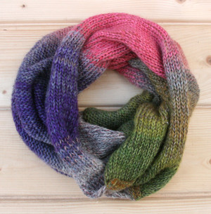 Petunia color way snood cowl flat on wood pallet background, knit by Inese Iris Liepina for Wrapture by Inese.