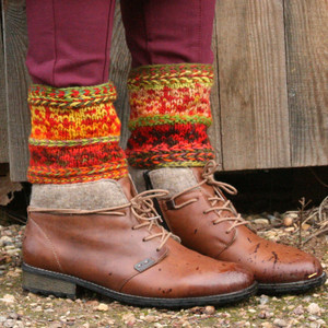 Sun sign boot toppers in Hawthorn color way hand knit by Inese Iris Liepina worn with ankle boots