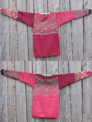 view of both sides of reversible unisex Roses inspired Latvian symbols sweater size M hung on woodshed wall, knit by Inese Iris Liepina
