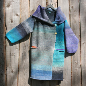 One of a kind felted wool coat knit by Inese with colors inspired by a New Zealand Lake. Size S , Photographed on my woodshed with shawl collar