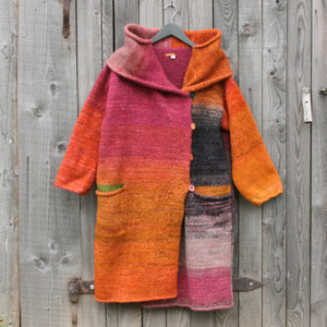 One of a kind felted wool coat knit by Inese with colors inspired by gerberas. Size S Photographed on my woodshed with shawl collar