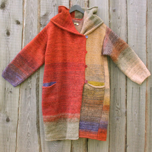 One of a kind felted wool coat knit by Inese with colors inspired by sumac trees in autum. Size M. Photographed on my woodshed with shawl collar buttoned into a snug collar cowl