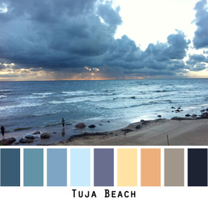 Tuja Beach - blue teal sky indigo gold peach tan black sunset glow  Baltic sea, sand and dark blue storm clouds, colors for blue green brown eyes, blonde hair, brunette, redhead, black hair - photo by Inese Iris Liepina, Wrapture by Inese