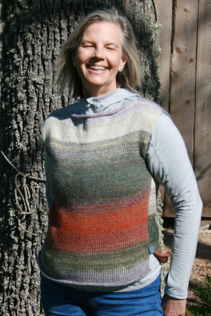 Side slit boatneck tank top worn by model in front of tree, custom order knit by Wrapture by Inese