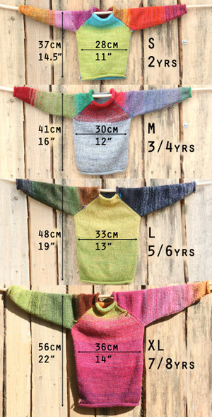 kids sizes S, M, L and XL raglan pullover sweaters hung on a wood shed with measurements to compare sizing Wrapture by Inese