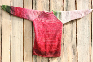 Custom order size adult S wool mohair reversible raglan pullover where the sweater is hung on a wood shed, designed and knit by Wrapture by Inese