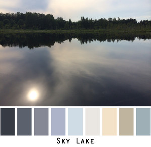 Sky Lake photograph made into a color card for custom orders. The sun is reflected in still waters of a lake. Photo by Inese Iris Liepina Colors include black, gray, sage, sky blue.