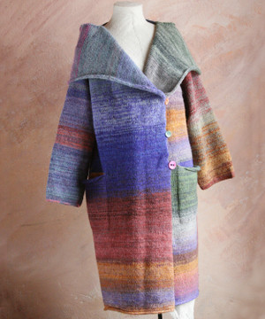 One of a kind felted wool coat knit by Inese with colors inspired by my Plum tree. Size S , shown on dress form with shawl collar and pocket details.
