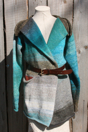 Greenstone Blue color card inspired Liene Sweater Coat in size  M on dress form, belted with wood wall background - Wrapture by Inese