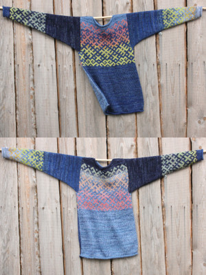 view of both sides of reversible unisex Sapphire Latvian symbols sweater size M on woodshed wall, knit by Wrapture by Inese