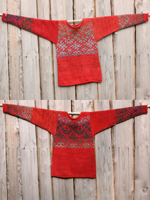 Fire red Latvian symbols sweater in size S knit with local wool, kid mohair, silk, cotton  by Inese, unisex, reversible, shown flat on wood wall in double exposure to show either side