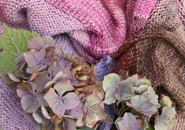 closeup of knitting with Hydrangea flower knit by Inese for Wrapture by Inese in lavender brown pink