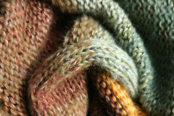 detail of knitting of Ancient Woods shawl wrap knit with gold sage green and beige yarns by Inese of Wrapture by Inese