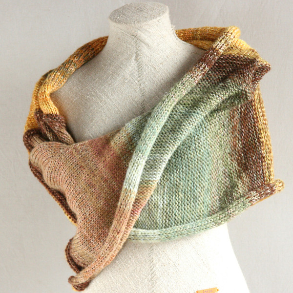 Ancient Woods shawl wrap on dress form knit by Inese for Wrapture by Inese in gold taupe and sage green colors