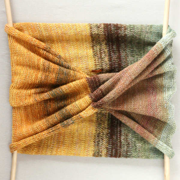 Ancient Woods shawl wrap on white background showing infinity scarf twist knit by Inese for Wrapture by Inese in gold taupe and sage green colors