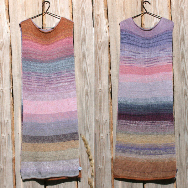 Plum color card inspired tank dress knit by Wrapture by Inese hung on side of woodshed