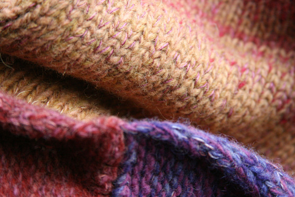 One of a kind Bitene M felted wool coat rolled hem detail closeup. Knit by Wrapture by Inese