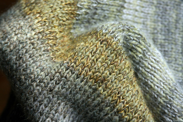 detail of ombre color change of knit Grey Leaves dress, knit by Inese Iris Liepina of Wrapture by Inese