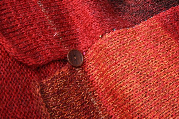 detail of side slit and button with ombre color change in knit Sumac dress, knit by Inese Iris Liepina of Wrapture by Inese