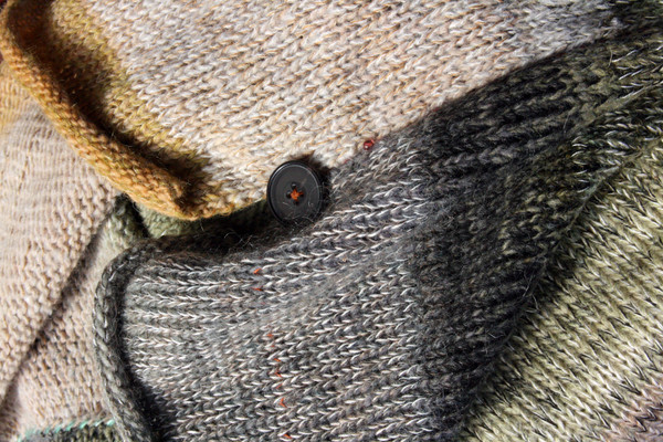 closeup of side slit and button detail in Birch Wood calf length tank dress knit by Inese Iris Liepina