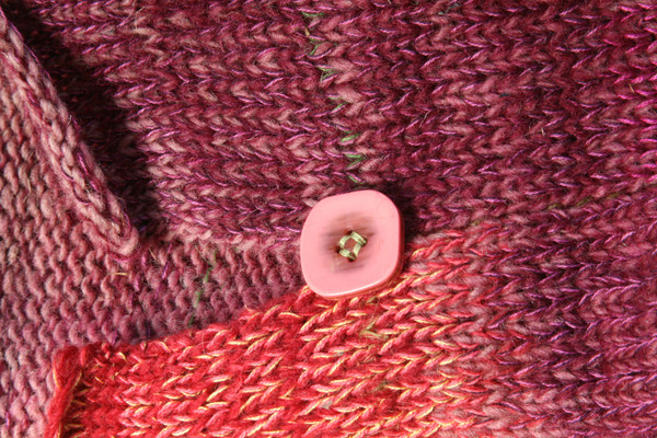 detail of side slit and button with ombre color change in knit Bitene dress, knit by Inese Iris Liepina of Wrapture by Inese