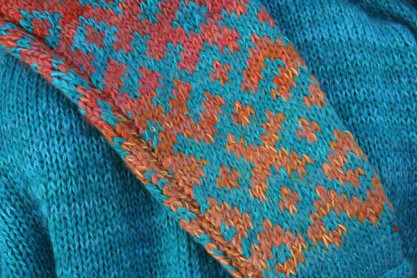 Turquoise blue Latvian symbols sweater size L detail of pattern knitting