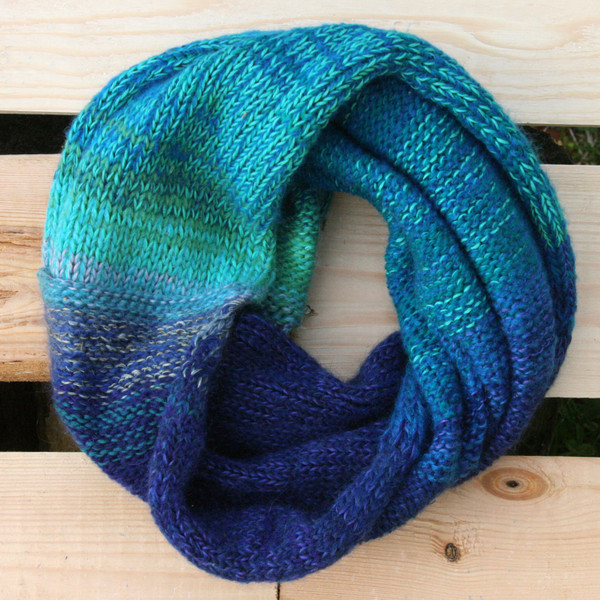 Winter Eve color way snood cowl flat on wood pallet background, knit by Inese Iris Liepina for Wrapture by Inese.